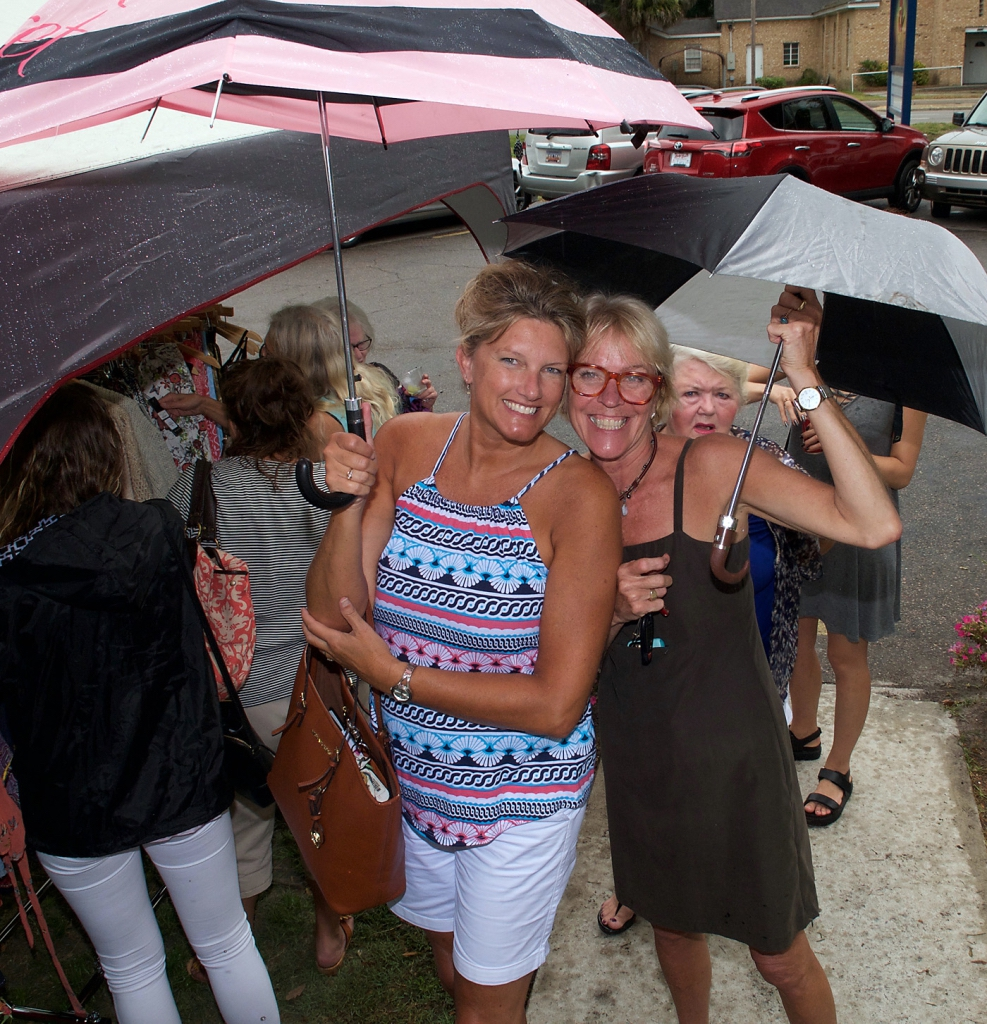 Kathy Clark, left, and Monica Pennington didn't let a little rain stop them from having a good time.