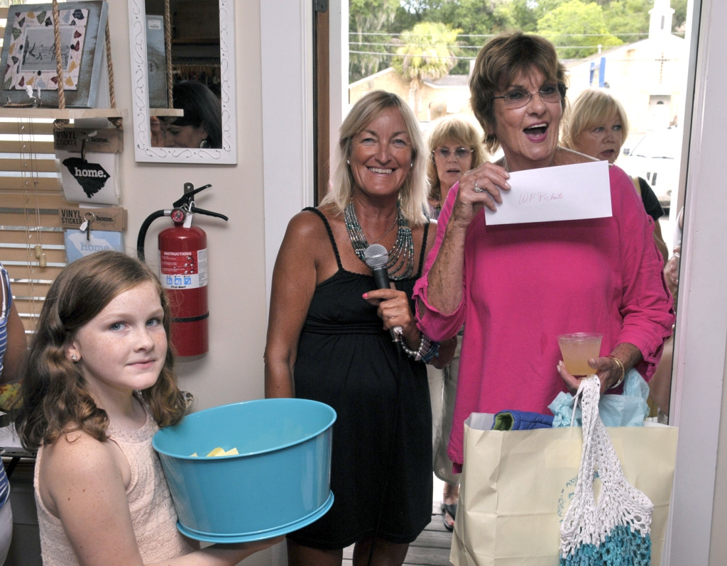 Irene Goodnight, center, presented all the door prizes, including a pair of Water Festival tickets given to this happy woman.