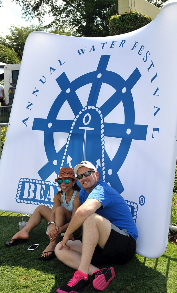 Febie Knight and husband Albert take a break and cool off in the shade July 16 during the 61st annual Beaufort Water Festival at Henry C. Chambers Waterfront Park.