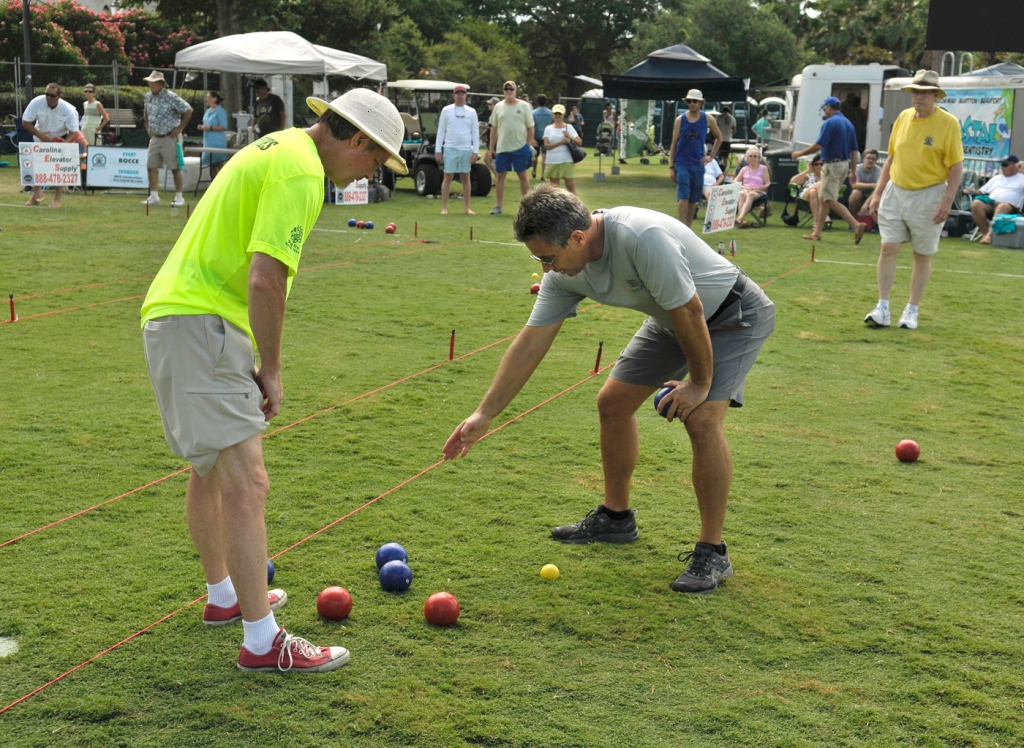 """Burton Sauls, left, listens as Greg Mauriocourt pleads his case during the annual Water Festival Bocce Ball Tournament on July 16 at Henry C. Chambers Waterfront Park. Mauriocourt and teammate Nick Hunt, won the contest, making them the winningest bocce ball team in festival history by nabbing their fifth tournament championship. """"We play about once a week at the Henry C. Chambers Waterfront Park,"""" Hunt said. """"We either team up together to play against each other with others who show up to play."""" This year's tournament hosted 17 teams in a double elimination tournament. Hunt and Mauriocourt won all five of their games."""