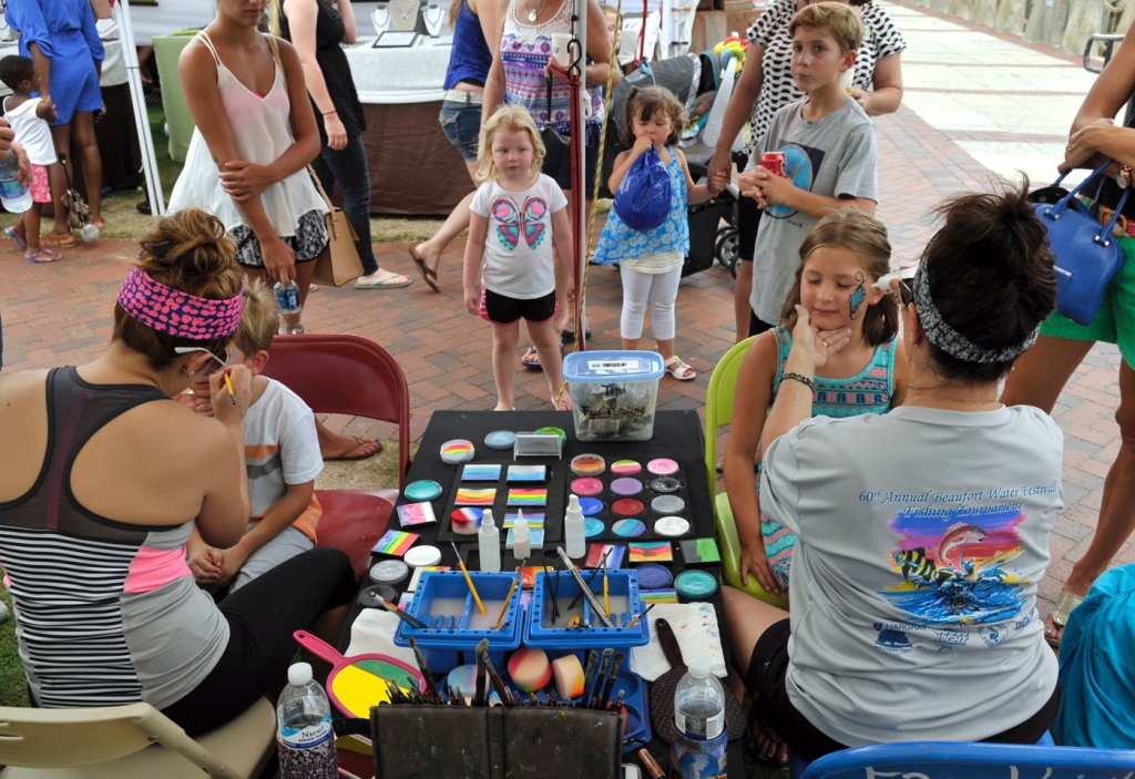 Erin Hancock, left, and her mother Mary Thibault of Thibault Gallery were busy painting designs on young faces during the annual Beaufort Water Festival Children's Day on July 16 Photo by Bob Sofaly.