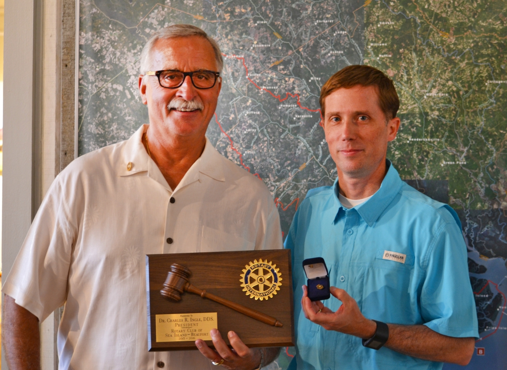 Outgoing Rotary Club President Dr. Chuck Ingle, left, is shown here with incoming Club President Paul Moore.