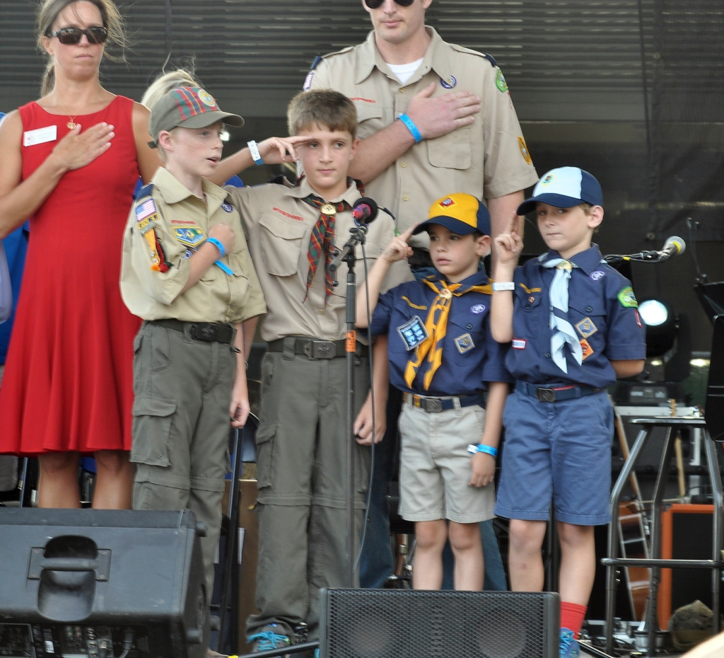 Cub Scouts and Webelos from Pack 1 at Carteret United Methodist Church were on hand to lead in reciting the Pledge of Alligence during the annual Beaufort Water Festival's opening ceremony on July 15. Photo by Bob Sofaly.