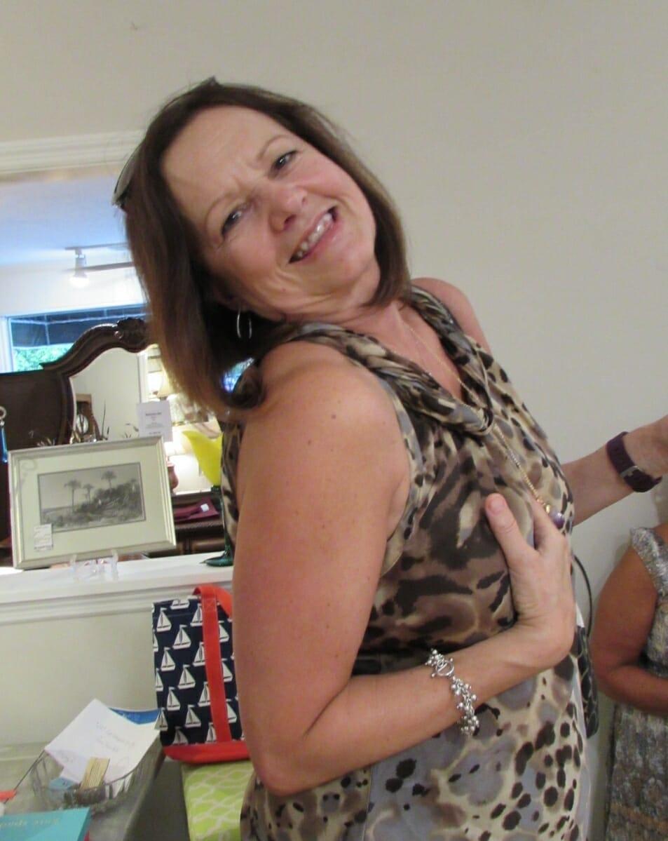 Rosemary Livingston models the amethyst pendant she won from Grace & Glory.