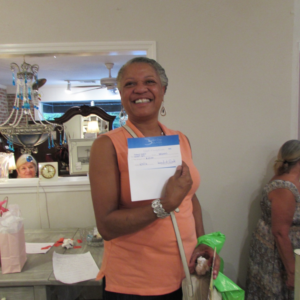 Treva Waller with her gift certificate to Beaufort River Glass