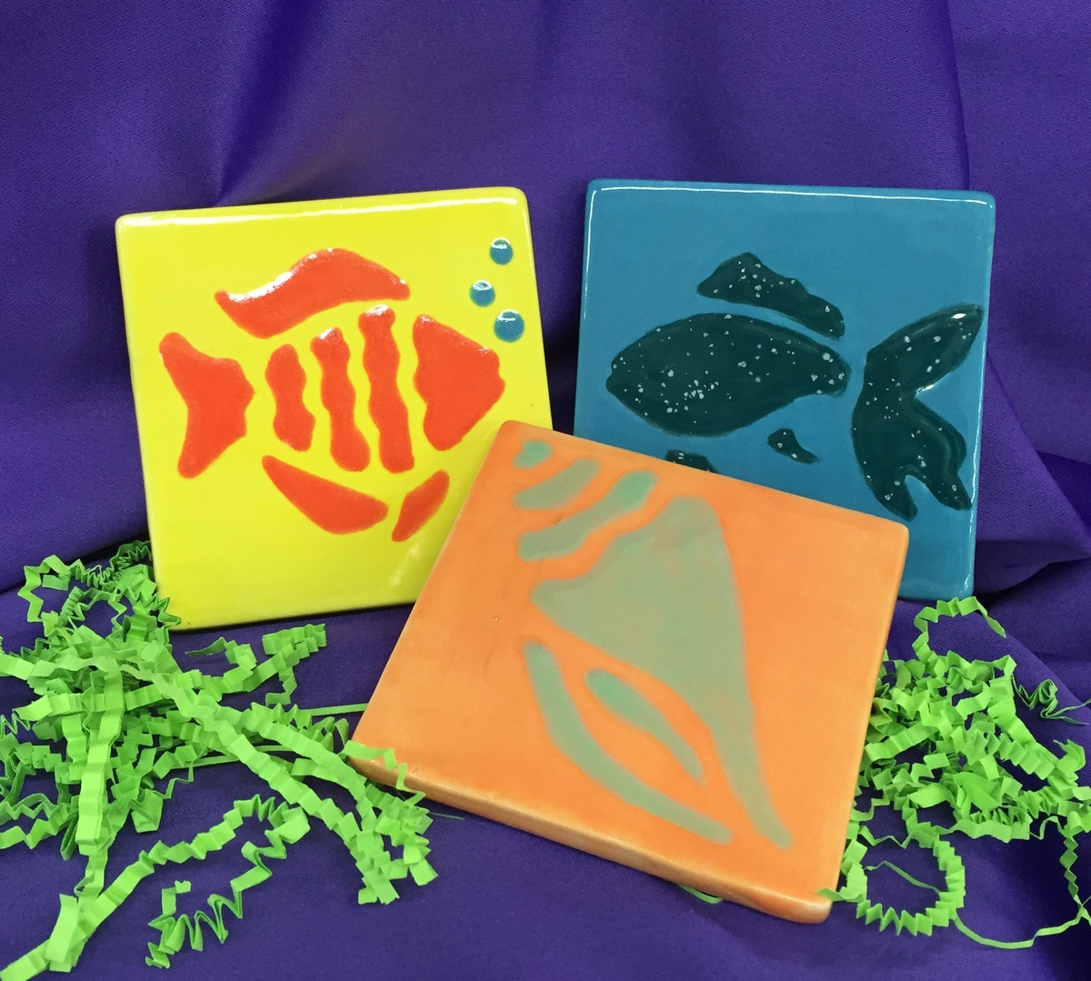 Hand-painted coasters have been added to Aunt Laurie's line of products.