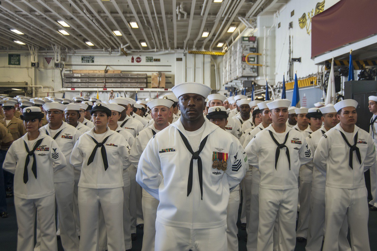 160804-N-EW322-033 SAN DIEGO (Aug. 4, 2016) – Aviation Structural Mechanic 1st Class Jamaan Fripp, from Beaufort, South Carolina, stands in formation with fellow USS Makin Island (LHD 8) Sailors during a change of command ceremony in the ship's hangar bay. Capt. Mark Melson relieved Capt. Jon P. Rodgers during the ceremony. The amphibious assault ship is homeported in San Diego. (U.S. Navy photo by Mass Communication Specialist Seaman Clark D. Lane/Released)