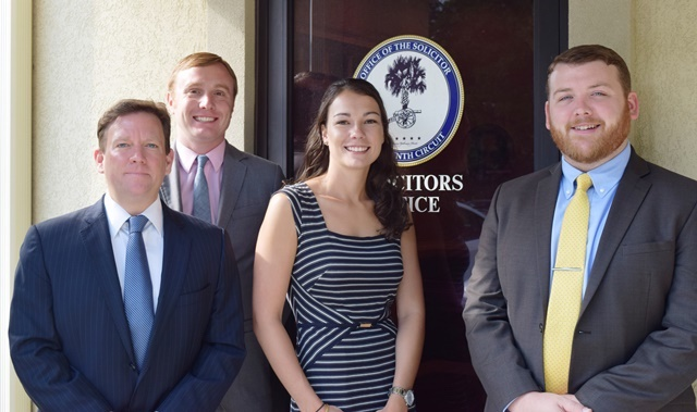 From left, Shane S. Scibelli and Kevin M. Phillips, both of the Charleston School of Law; Charlotte Loper of Wake Forest University School of Law; and Patrick Sancomb of the Savannah Law School recently completed an intensive eight-week externship with the Fourteenth Circuit Solicitor's Office.