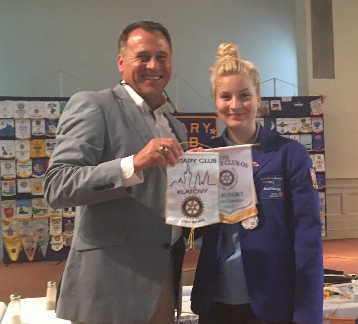 As one of it major programs, the Rotary Club of Beaufort supports exchange students attending Beaufort schools. The first of two exchange students for school year 2016-17 are Karolina Struharova, right, from the Czech Republic. Here, she exchanges the banner from her home Rotary, Klatovy, Czech Republic, with Rotary Club of Beaufort President Willie Mack Stansell. Struharova will be a junior at Beaufort Academy. Photo by Lisa Harrington.