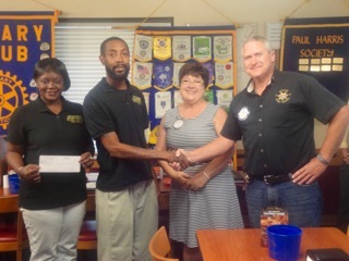 The Rotary Club of the Lowcountry President Alan Beach (far right) and Past President Charlotte Gonzalez (second from right) present brother and sister business owners Melissa and Charles Jones, of Jones Boxing Academy, with a check of support. Charles Jones said the money will help offset travel and food expenses when his boxers compete around the state and throughout the Southeast region. Jones Boxing Academy is located on Eastern Road in Beaufort and trains boxers from all over Beaufort County.