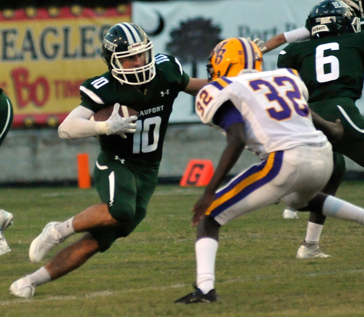 """Beaufort's Wyatt """"White Lightning"""" Sherpensky, left, weaves his way through the Whale Branch defense to score his first touchdown of the Sept. 9. Photo by Bob Sofaly."""