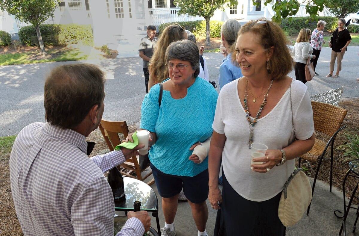 Susan Bishop, right, and Judy Dykema enjoy refreshments.