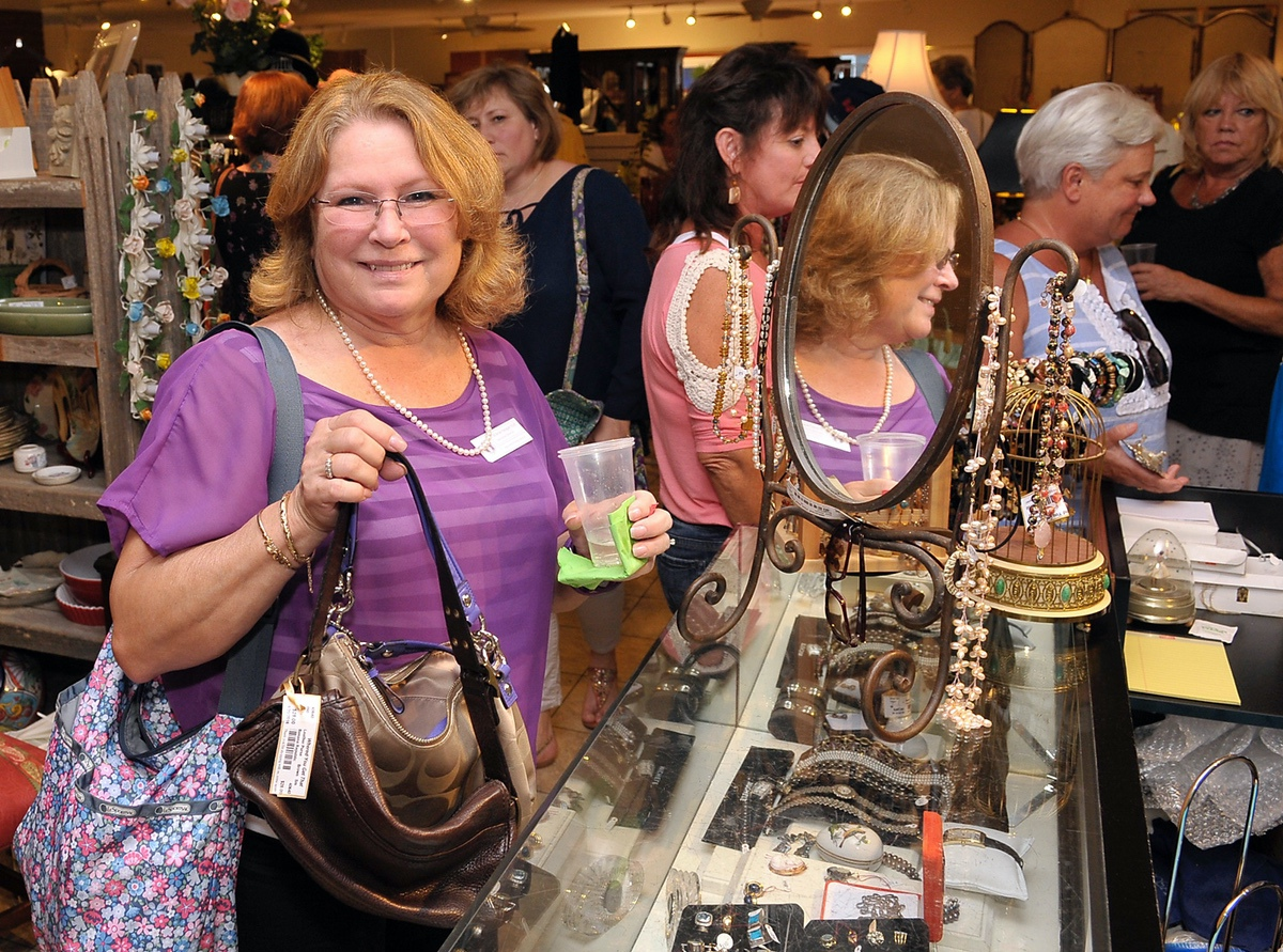 Arlene Heape checks out the jewelry. Photos by Bob Sofaly.