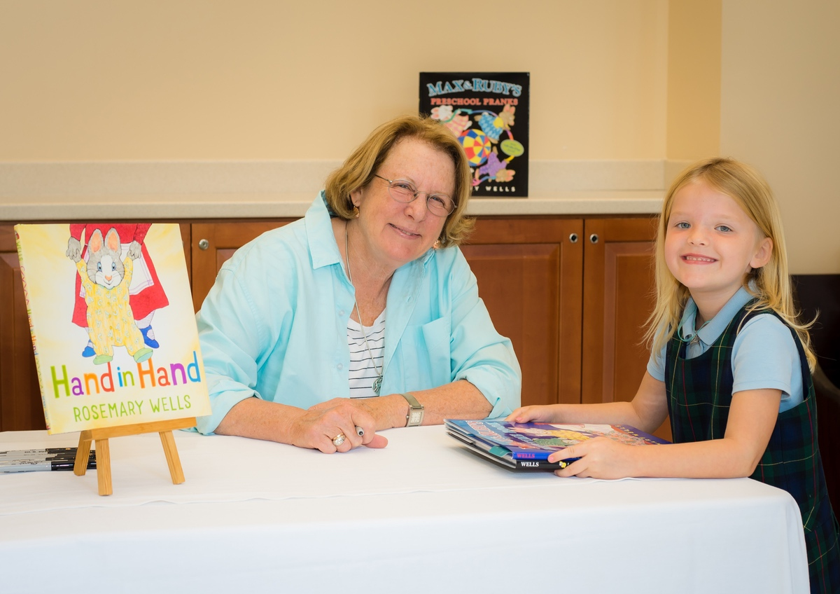 """Rosemary Wells, author and illustrator of the popular children's series """"Max & Ruby,"""" selected Cross Schools as the first stop in a tour to promote her latest book, """"Hand in Hand."""" The event featured a meet-and-greet and book signing, as well as a Young Artists Workshop for grades K-4, and a Young Writers Workshop for grades 5-8. Cross Schools is an independent Christian school in Bluffton serving children from 18 months through eighth grade. Wells is shown here with kindergartener Zoe Vermilyea, daughter of Kate and Jody Vermilyea."""