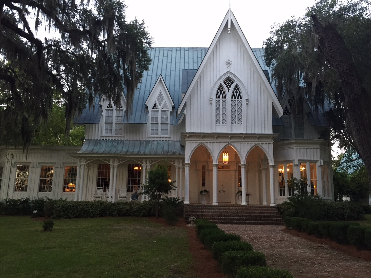 Guests at the wine tasting were able to wander around the mansion while docents explained the historical significance of the mansion, furniture and art.