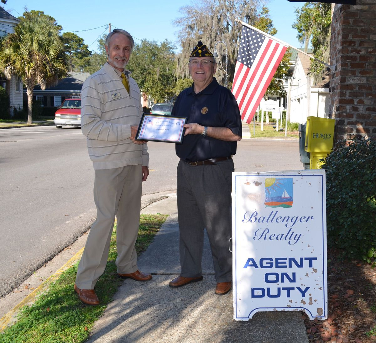 American Legion Post 9 Commander Chuck Lurey presents Everett Ballenger a certificate of appreciation to recognize local businesses that display the American flag.