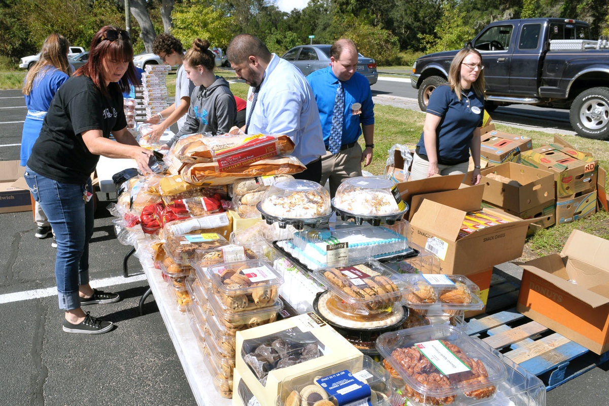 Some of the food items being given away included cakes, pies, pastries, water and fresh fruit and vegetables. Photo by Bob Sofaly.