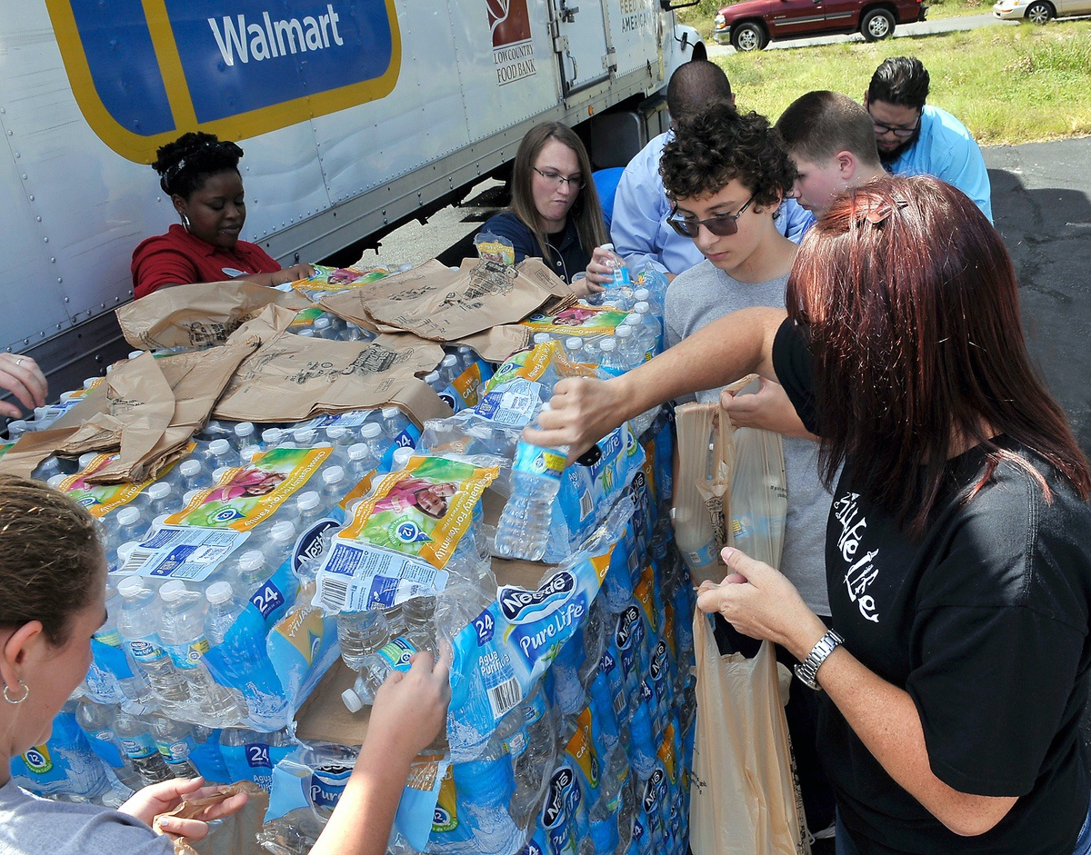 Bottles of fresh water were bagged and given away to those who needed it. Photo by Bob Sofaly.