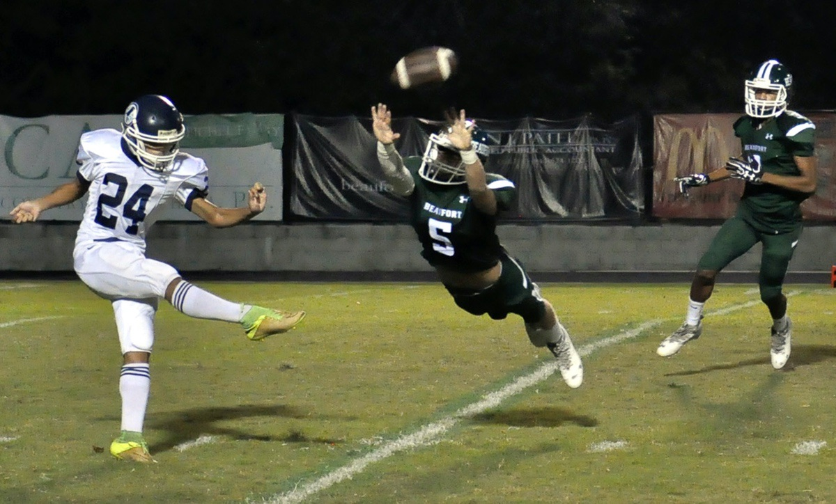 Beaufort's Jeffrey Smyth, center, just misses blocking Stall's punt during the first quarter Friday night at Eagle Stadium. The Eagles won the game 60-7. Photo by Bob Sofaly.