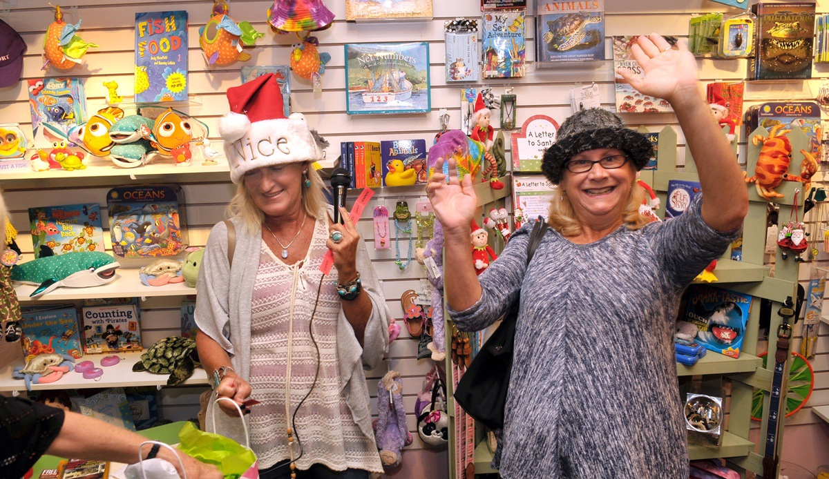 Mary Wallace, right, reacts after winning the first door prize of the night at Hollyhocks on Bay Street.