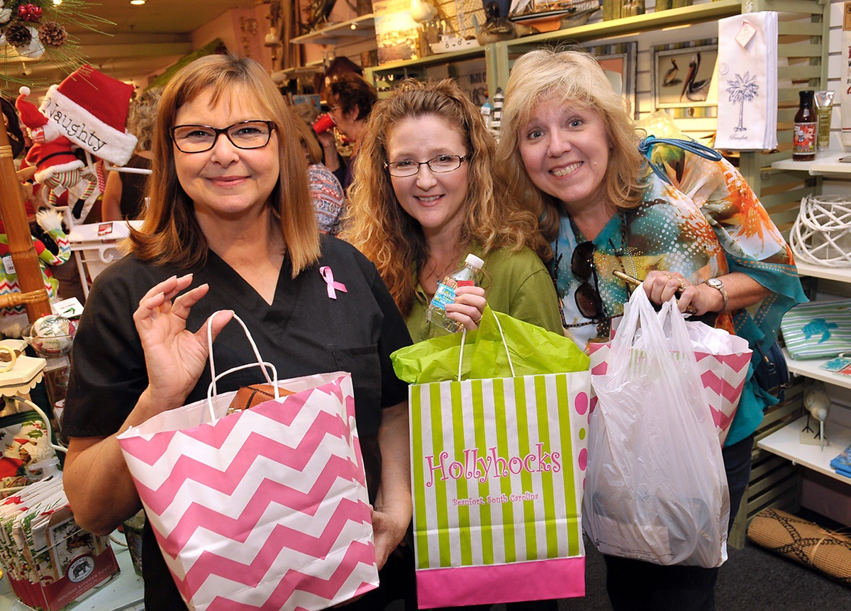 Friends Velma Polk, left, Elaine Lake and Susan Stott-Smith pose together after all three win door prizes.