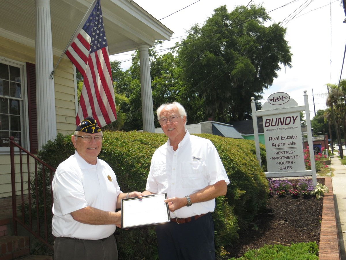 American Legion Beaufort Post 9 is striving to promote both patriotism and businesses in the Beaufort area by calling attention to those that proudly display the U.S. flag at their location. Post 9 presents those enterprises with a framed certificate thanking them. Here, Bundy Real Estate Appraisals is recognized with a certificate from Post Commander Chuck Lurey.