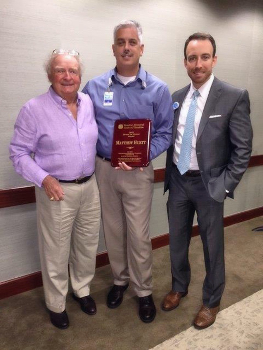 """Matthew Hurt, center, is the recipient of the 2016 """"Spirit of Giving"""" Award. He is shown here with Beaufort Memorial Foundation Chairman Hugh Gouldthorpe and Beaufort Memorial Hospital CEO Russell Baxley."""
