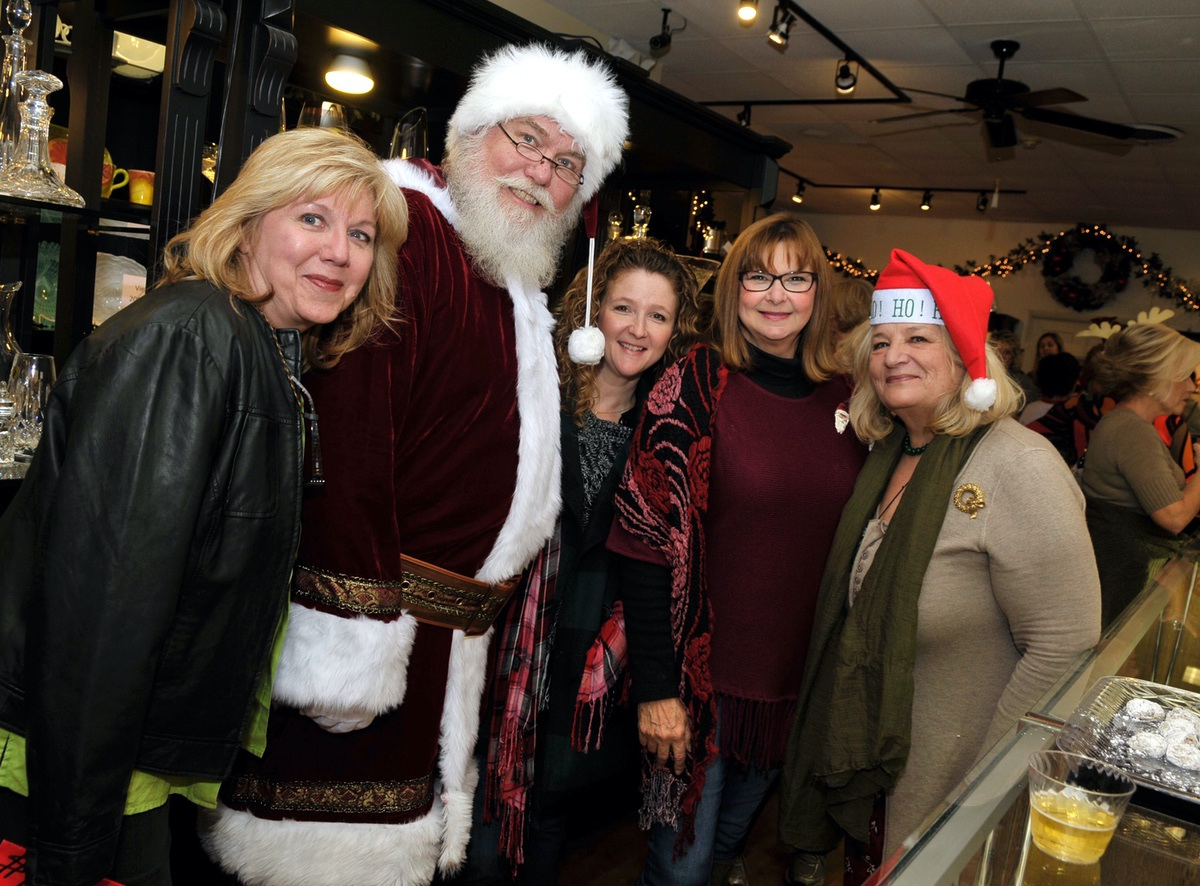 Santa has his hands full during Island Girls Night Out at Modern Jewelers on Bay Street.