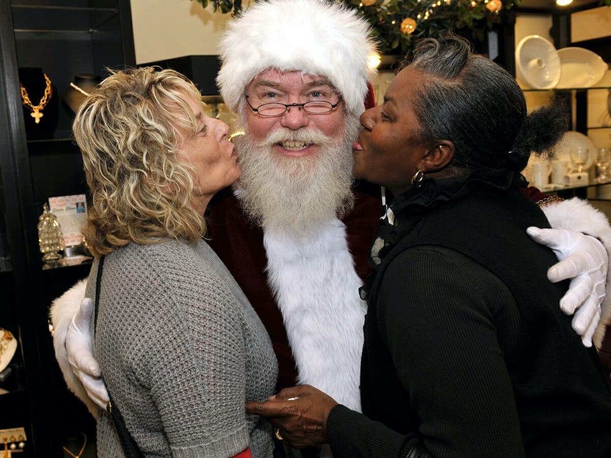 Shirley Martin, left, and Pat Gadsden give Santa a big kiss.