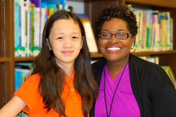 Student Cheyenne Ly poses with Ashley Jenkins, Beaufort County recycling coordinator.