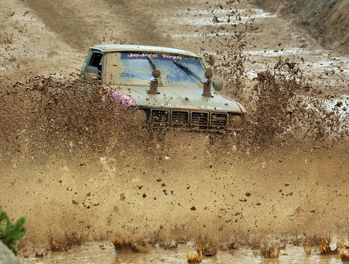 A Toyota truck slugs its way through the mud pit during the Yemassee Mud Run in May.