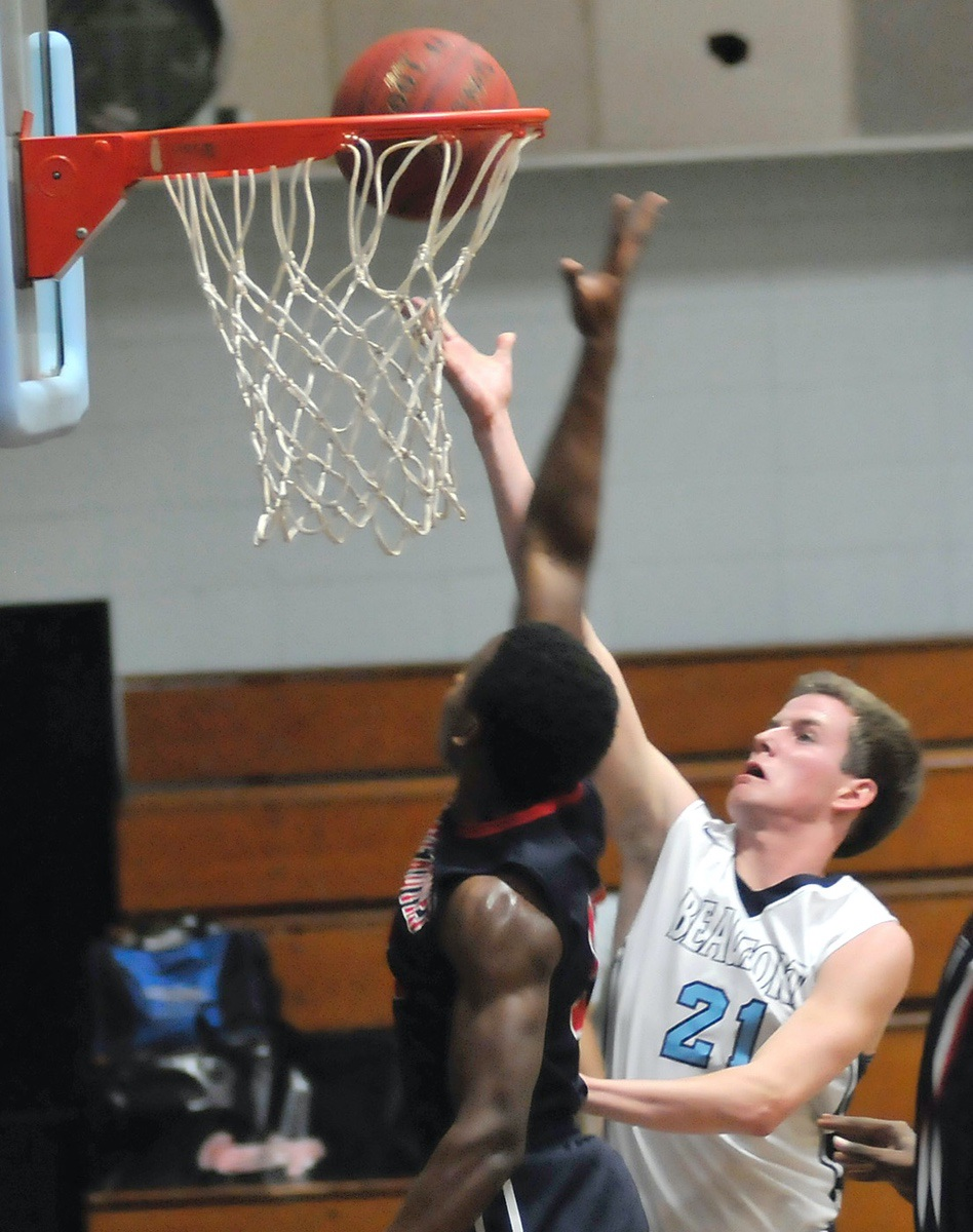 Luice Harper, right, tries for a layup against a stiff Hilton Head Prep defense on Jan. 20 at Beaufort Academy.
