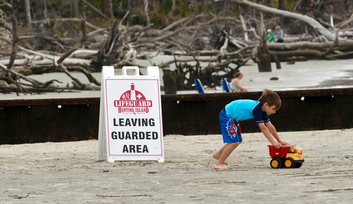 An unidentified boy pushes his toy truck near one of the groins along the beach at Hunting Island State Park. The park suffered major damage recently from Hurricane Matthew.