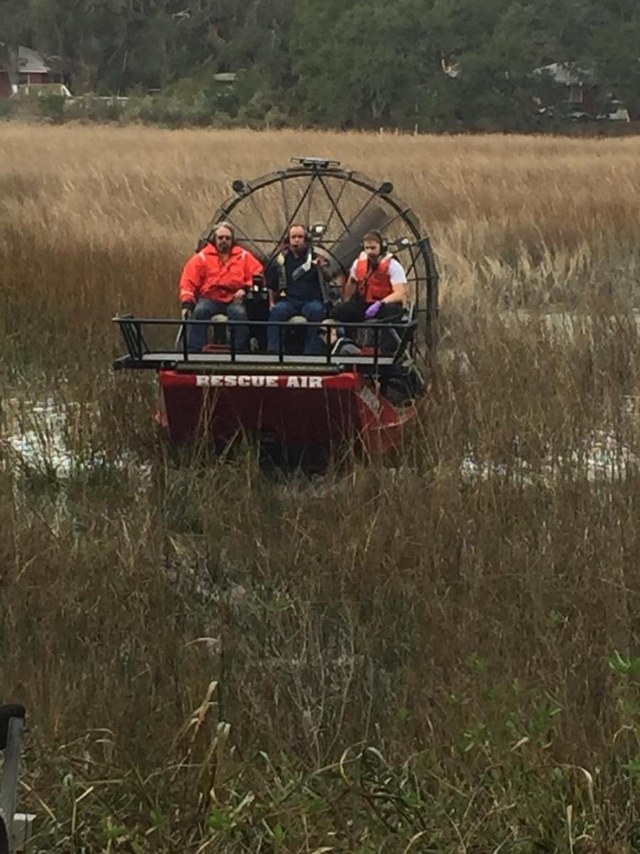 The Beaufort Marine Rescue Squad used its airboat to rescue a man and dog stuck in pluff mud.