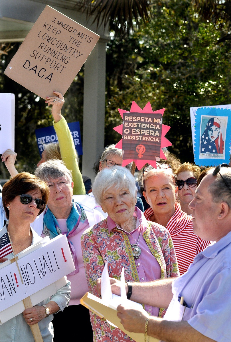 Mitch Siegel, far right, rally organizer, discusses President Donald Trump's immigration policy during a rally Feb. 7 at U.S. Rep. Mark Sanford's Beaufort office.