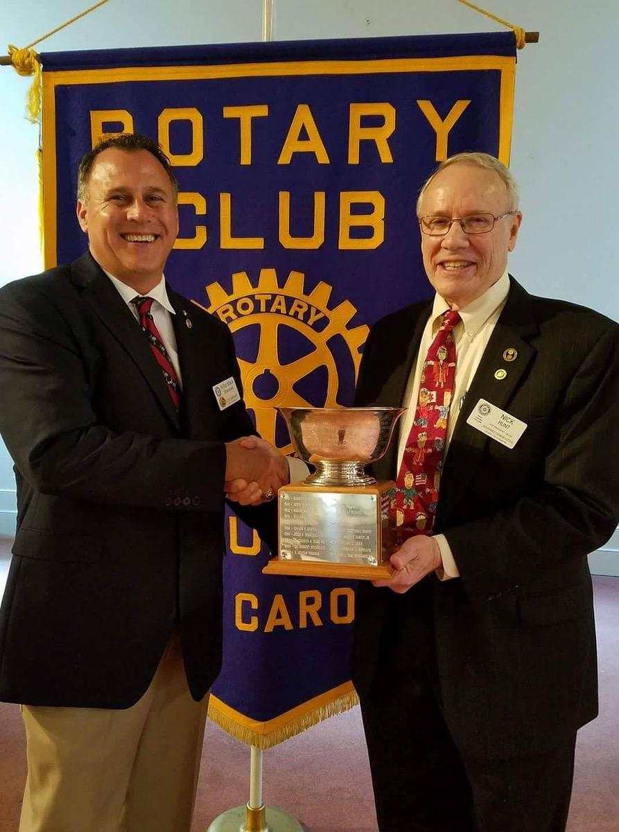 Beaufort resident Nick Hunt is the 2016 recipient of the Rotary Bowl, the Rotary Club of Beaufort's highest honor. For more than 40 years, Hunt has worked tirelessly in both his Rotary Club and his community.  He served with the local United Way for five years, he was on the board of the Salvation Army for five years, he recently completed two years as a board member of his church, and he has been a guardian with power of attorney for numerous patients with dementia at Summit Place. At left, Willie Mack Stansell, III, president of the Rotary Club of Beaufort, presents The Rotary Bowl, the most prestigious award of the club, to Hunt, at right, during the club's Feb. 8 meeting. Photo by Suzi Oliver.