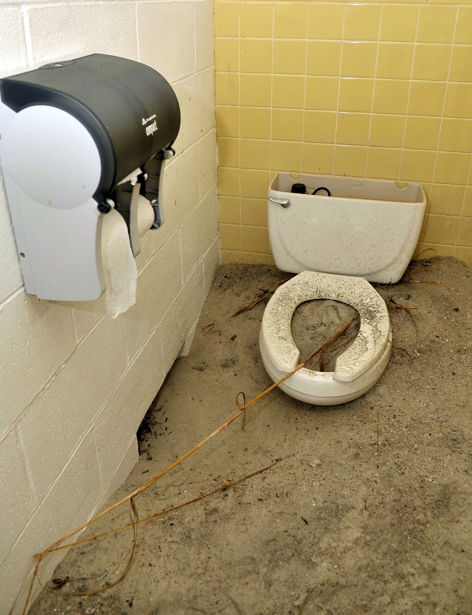 A toilet filled with sand shows how extensive the damage done to the state park's waste disposal system. The entire system needs to replaced.