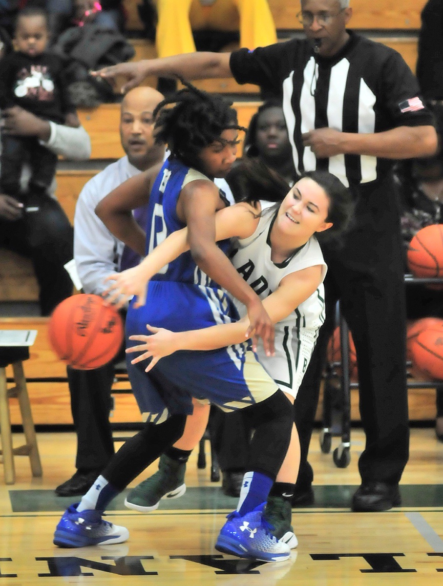 Beaufort High School's Caroline O'Hara, right, passes the ball behind the back of Berkeley's Jasmia Gadsden on Feb. 3 during their Region Vlll, Class-AAAA basket ball game at BHS. Photo by Bob Sofaly.