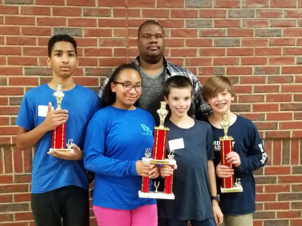 The Beaufort Academy Middle School Chess team placed first overall in the Middle School Division of the Ogeechee River Scholastic Chess Tournament on Jan. 21. Pictured from left are Kevin Rogers, Kendra Rogers, G Simmons and Jack McDougall, who won an individual award for winning second place.