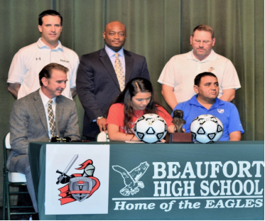 Heily Hernandez and Omar Cummings signed National Letters of Intent last week. The Beaufort High School student-athletes were joined by friends and family in a signing ceremony held at Beaufort High School. Hernandez signed to play soccer for North Greenville University. Photo courtesy of Beaufort High School.