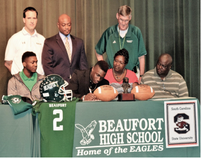 Omar Cummings signs to play football for South Carolina State University. Photo courtesy of Beaufort High School.