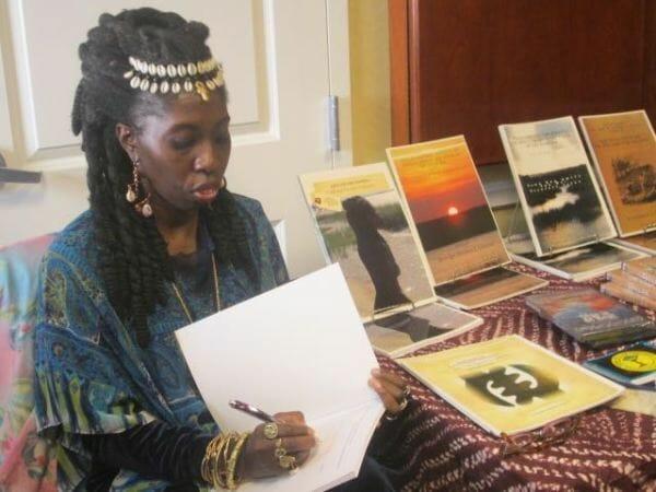 Queen Quet signs copies of her book.