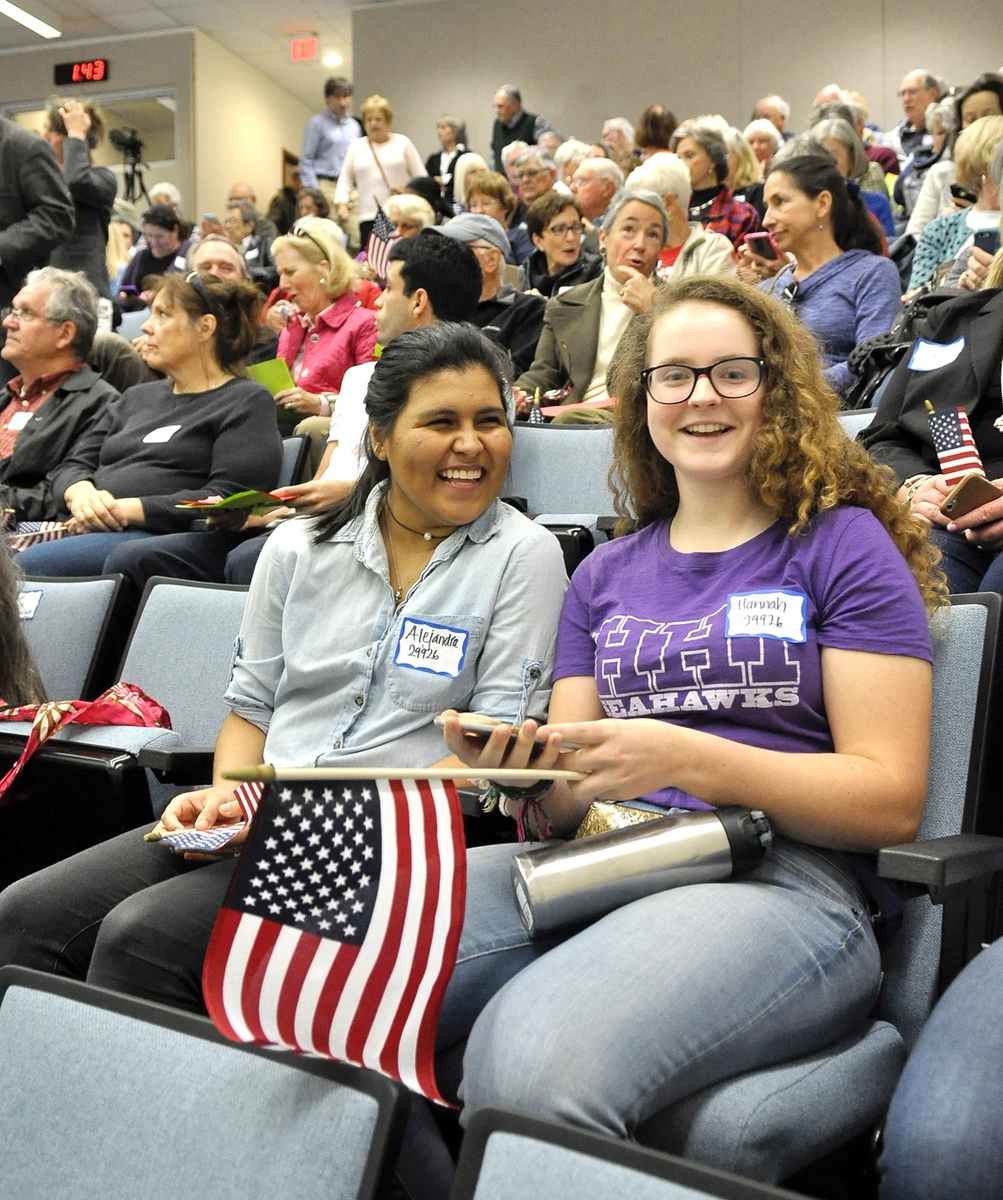 Alejandra Jordan, 15, left, and Hannah Aytell, 15, both from Hilton Head High School's Young Democrats Club, wait for Rep. Mark Sanford, R-SC, at a town hall meeting.