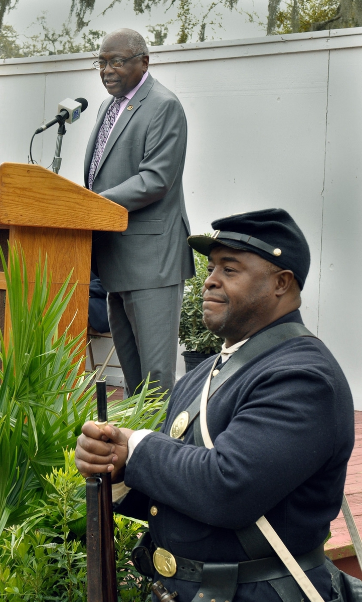 U.S. Sen. James Clyburn, D-SC, makes his remarks while Union soldier re-enactor Terry James of Company I, 54th Mass., stands guard during the unveiling ceremony of the National Park Service Reconstruction Era National Monument on Saturday at Penn Center on St. Helena Island.
