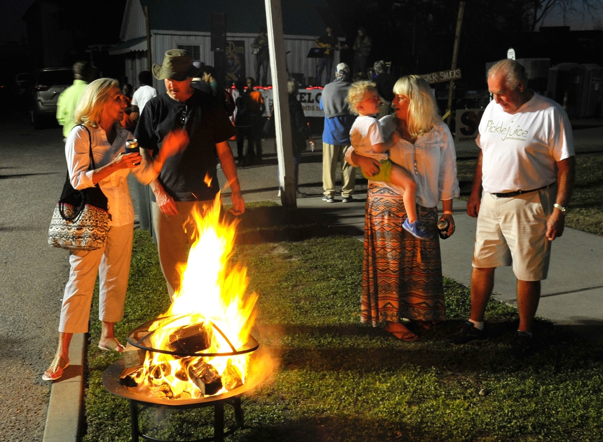 Patrols at the annual Bands, Brews & BBQ warm themselves by one of several fires in Port Royal.