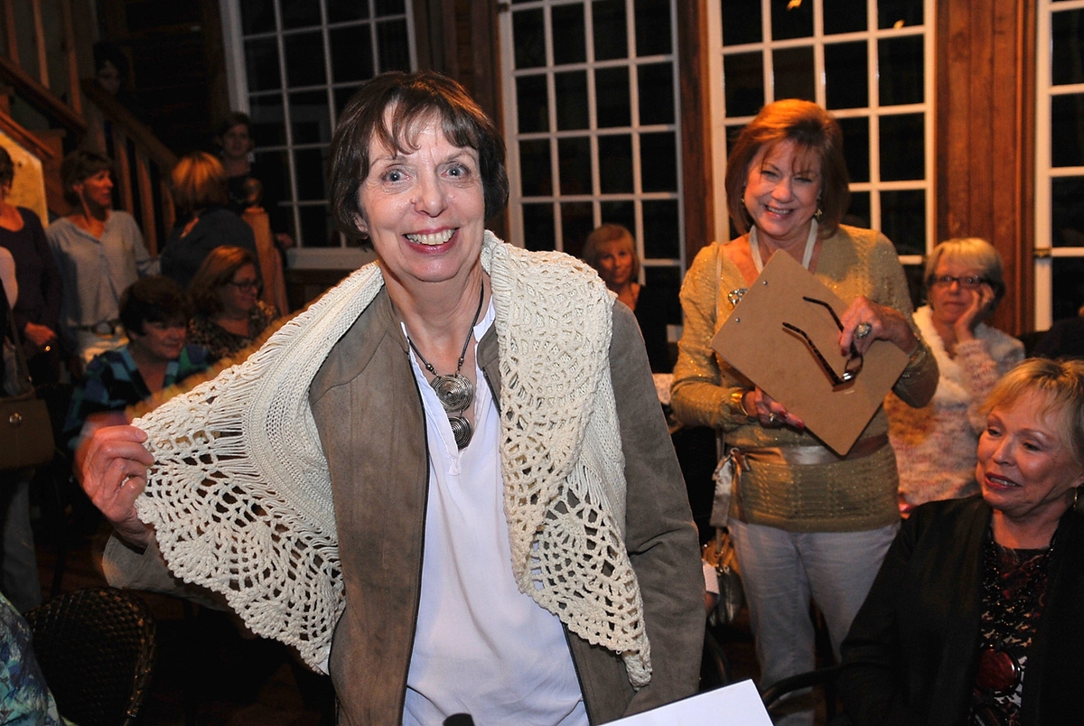Barbara Ulrich shows off her crocheted shawl from that she won as a door price recently during Island Girls Night Out at MoonDoggies.