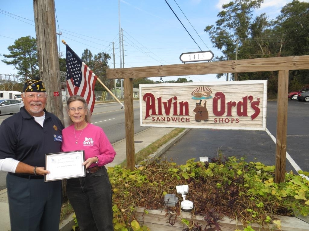 American Legion Beaufort Post 9 is striving to promote both patriotism and businesses in the Beaufort area by calling attention to those that proudly display the U.S. flag at their location. Post 9 presents those enterprises with a framed certificate thanking them. Here  1st Vice Commander Bob Shields thanks Marie Lewis, owner of Alvin Ord's Sandwich Shop, for showing the flag.