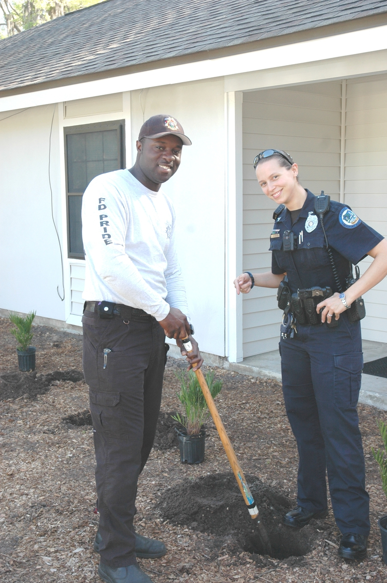 Police and fire volunteers help with the plantings on Duke Street on March 27. Photo provided.