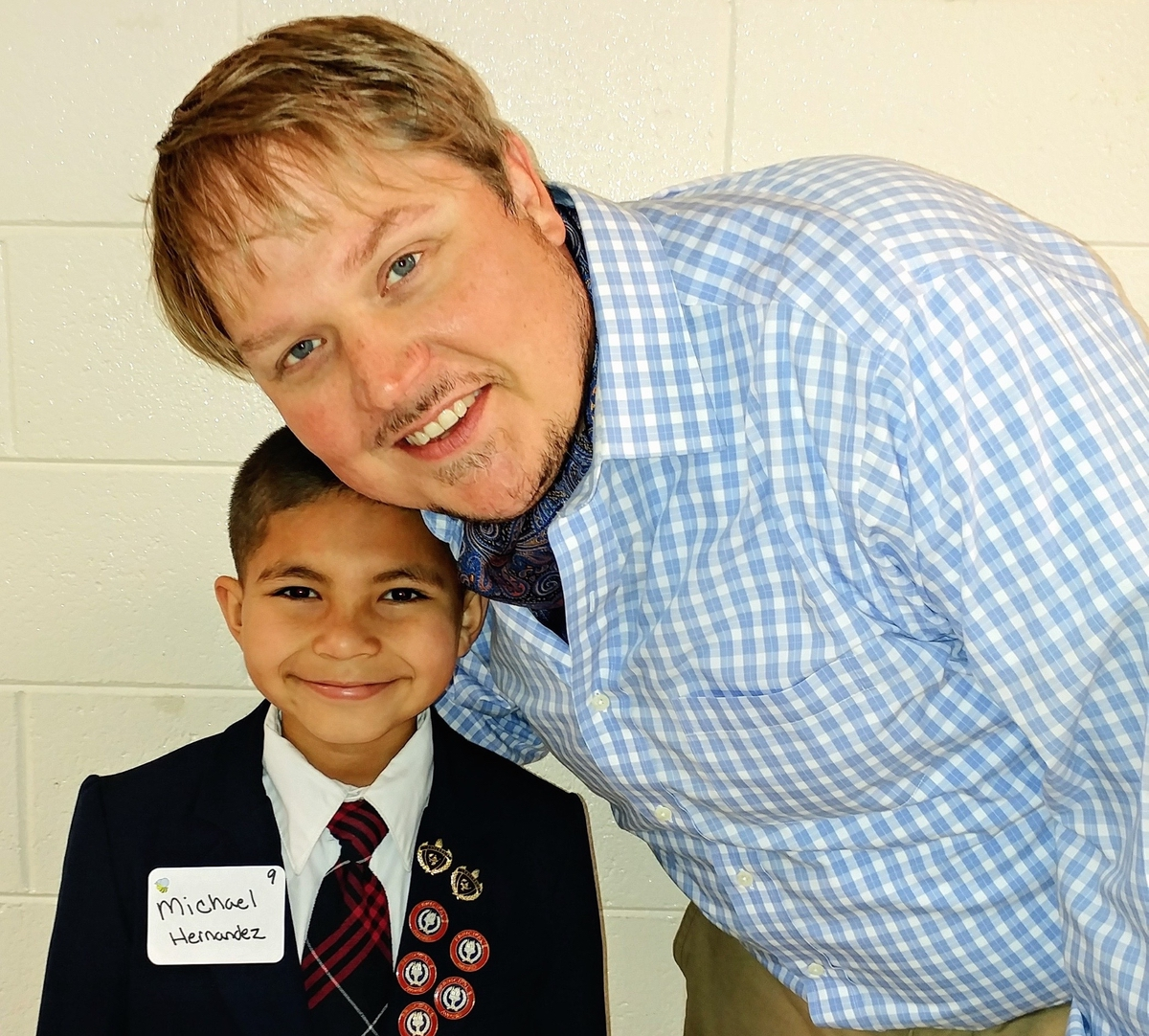Holy Trinity third-grader Michael Hernandez placed in the top 10 at the SCISA state spelling bee. His teacher, Paul Newman, attended the competition held in Kingstree.
