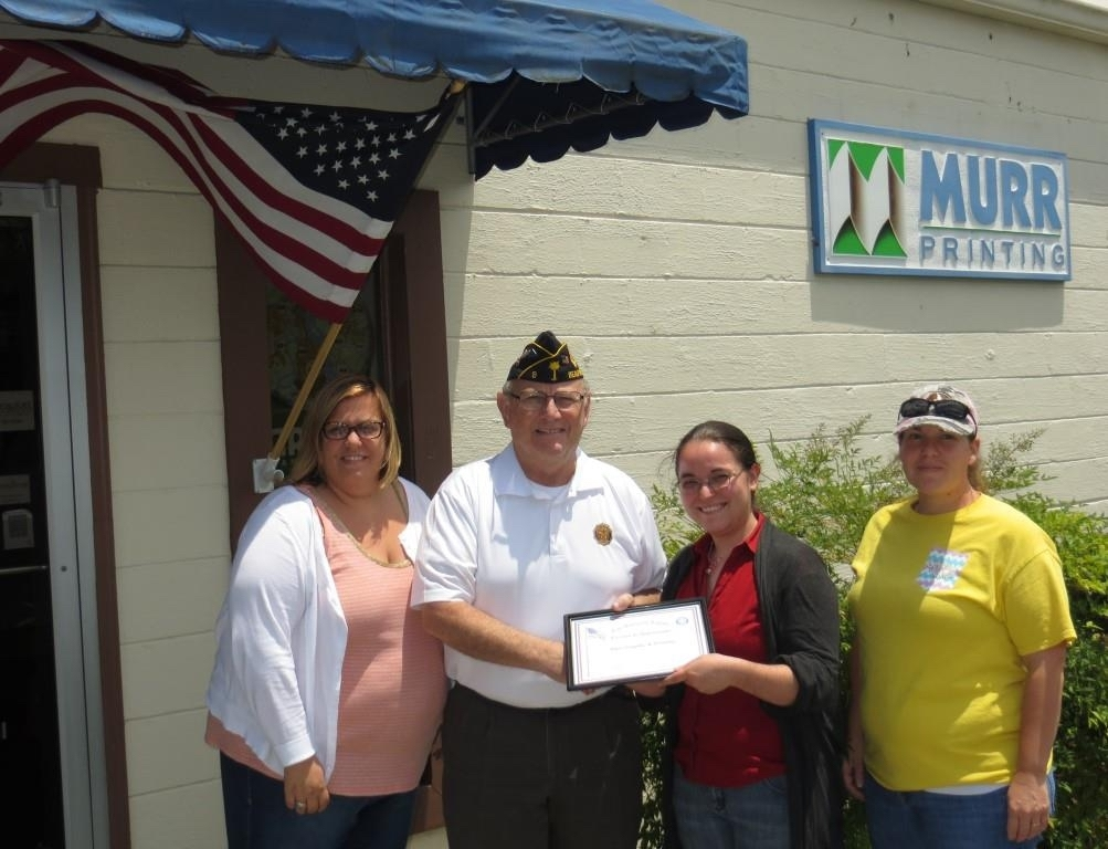 American Legion Beaufort Post 9 is striving to promote both patriotism and businesses in the Beaufort area by calling attention to those that proudly display the U.S. flag at their location. Post 9 presents those enterprises with a framed certificate thanking them. Here Post 9 Commander Chuck Lurey presents the staff a certificate thanking Murr Printing for displaying the flag. From left are Sarah Evenden, Lurey, Victoria Orem and Mary Crosby.